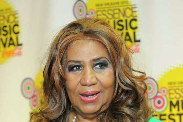 Aretha Franklin poses for photos at the Essence Music Festival in New Orleans on Sunday, July 8, 2012.  (Photo by Cheryl Gerber/Invision/AP)