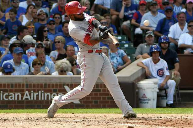 Cincinnati Reds' Phillip Ervin hits a two-run home run against the Chicago Cubs during the seventh inning of a baseball game, Thursday, Aug. 17, 2017, in Chicago. (AP Photo/David Banks) ORG XMIT: CXC125