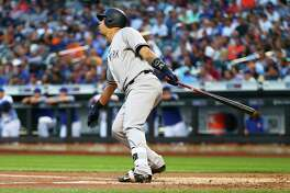 NEW YORK, NEW YORK - AUGUST 17:  Gary Sanchez #24 of the New York Yankees connects on a first inning 3-run home run against the New York Mets at Citi Field on August 17, 2017 in the Flushing neighborhood of the Queens borough of New York City.  (Photo by Mike Stobe/Getty Images) ORG XMIT: 700012071