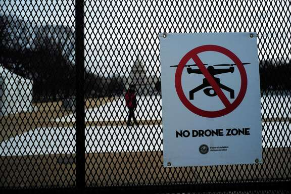 """A sign reading, """"No Drone Zone,"""" is placed on a security fence at the National Mall in Washington ahead of President-elect Trump's inauguration. Airports too are concerned about drone incursions, though they are still figuring out how to combat the problem."""