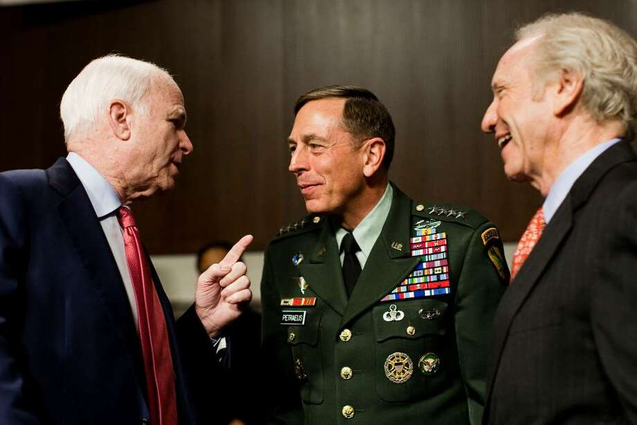 Sen. John McCain, R-Ariz., and the ranking Republican on the Senate Armed Services Committee, left, and committee member Sen. Joseph Lieberman, I-Conn., right, talks with U.S. Central Commander Gen. David Petraeus, on Capitol Hill in Washington, Wednesday, June 16, 2010, prior to Petraeus testifying before the committee.  (AP Photo/Drew Angerer) Photo: Drew Angerer, ASSOCIATED PRESS / AP
