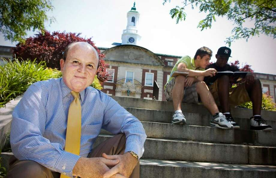 Dr. Michael Intrieri, Director of Student Activities, sits in front of Stamford High School. The school's spokesman is retiring after 40 years in Stamford, Conn. on Friday June 18, 2010. Photo: Kathleen O'Rourke / Stamford Advocate