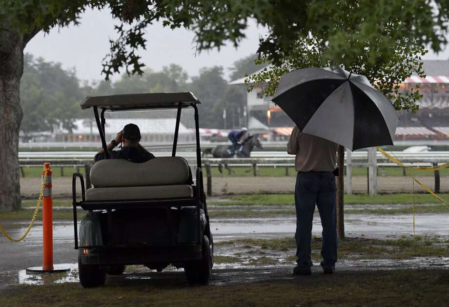 It might have been raining in Saratoga Springs - and the rest of the Capital Region - Friday morning but trainers trained and horses ran at Saratoga Race Course. Photo: Skip Dickstein / Times Union