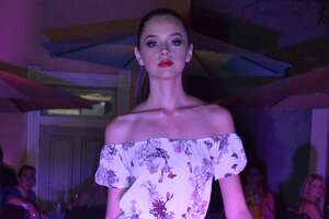 Models walk the runway at the Laredo Fashion Week fashion show at Siete Banderas on Wednesday evening.