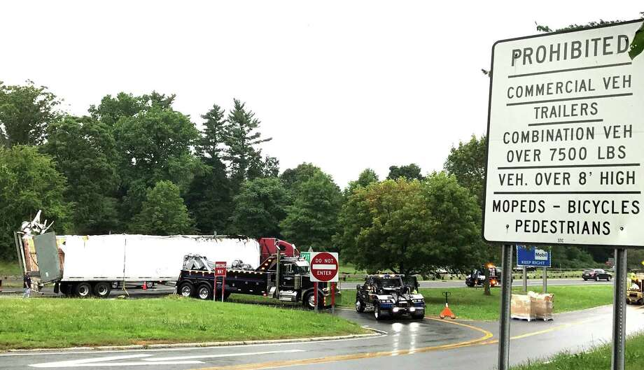A tractor-trailer  awaits a tow after it struck an overpass in New York near Greenwich, Conn. The accident caused major delays on the Merritt and Huchinson River parkways Friday, Aug. 18, 2017. Photo: Contributed Photo / Konrad Flejter / Contributed Photo / Connecticut Post Contributed