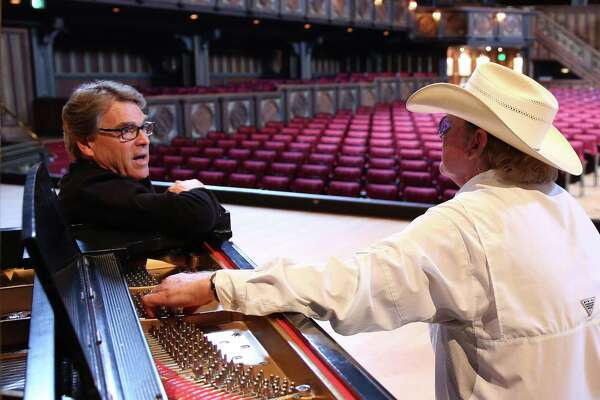 "Former Texas Gov. Rick Perry sits with country singer Gary P. Nunn while making a video promoting Texas tourism. The campaign uses Nunn's song, ""What I Like About Texas"" to promote the Texas brand at a time that critics say the Texas Legislature is hurting the state's reputation by considering legislation that would discriminate against transgender people."