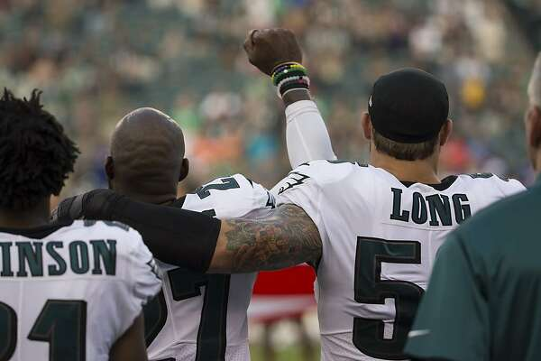 PHILADELPHIA, PA - AUGUST 17: Malcolm Jenkins #27 of the Philadelphia Eagles holds his fist in the air while Chris Long #56 of the Philadelphia Eagles puts his arm around him during the national anthem prior to the preseason game against the Buffalo Bills at Lincoln Financial Field on August 17, 2017 in Philadelphia, Pennsylvania. (Photo by Mitchell Leff/Getty Images)