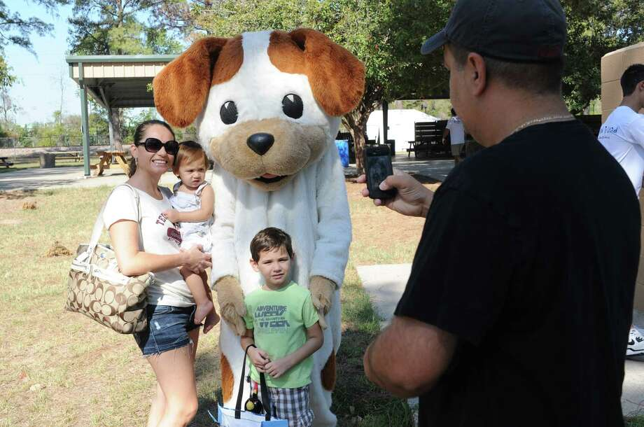 At a family literacy event in 2011, Juan Rendon photographed his family with the Poky Little Puppy at Juergens Park. Photo: Thomas Nguyen, For The Chronicle / Freelance