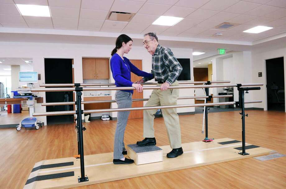 Physical therapist Lauren Donovan, left, works with patient John Kimball at the Greenwich Hospital/Yale New Haven Health System facility, an outpatient center, at the Long Ridge Medical Center in Stamford, Conn., on Tuesday, Feb. 21, 2017. Photo: Bob Luckey Jr. / Hearst Connecticut Media / Greenwich Time