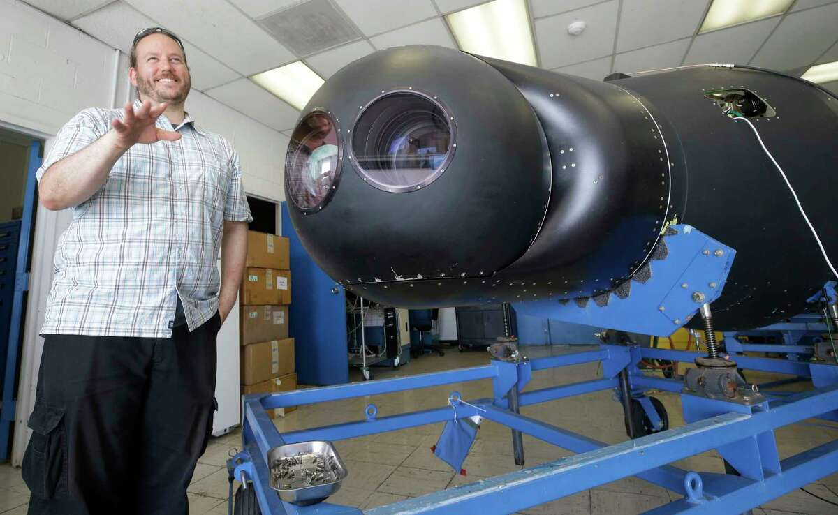Amir Caspi, Southwest Research Institute senior research scientist, talks about the equipment in the nose cone of the NASA WB-57F jet that will be used for research during the eclipse shown at Ellington Airport Thursday, Aug. 10, 2017, in Houston. Two WB-57F jets will be flown from Ellington Airport to observe Mercury and the sun at 50,000 feet during the eclipse using telescopes with cameras. ( Melissa Phillip / Houston Chronicle )