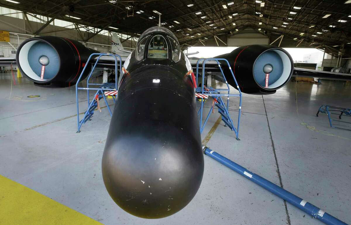 A NASA WB-57F jet is shown at Ellington Airport Thursday, Aug. 10, 2017, in Houston. Two of the WB-57F jets will be flown from Ellington Airport to observe Mercury and the sun at 50,000 feet during the eclipse using telescopes with cameras. Amir Caspi, Southwest Research Institute senior research scientist, talked about the equipment that will be placed into the nose cone of the jets. ( Melissa Phillip / Houston Chronicle )