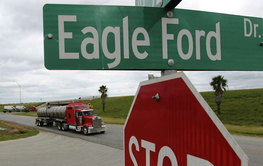 A tanker truck drives along the access road of Interstate 35 near Eagle Ford Drive in Cotulla. Energy jobs went up by 2,100 in July in Texas. Photo: San Antonio Express-News File Photo / ©2014 San Antonio Express-News