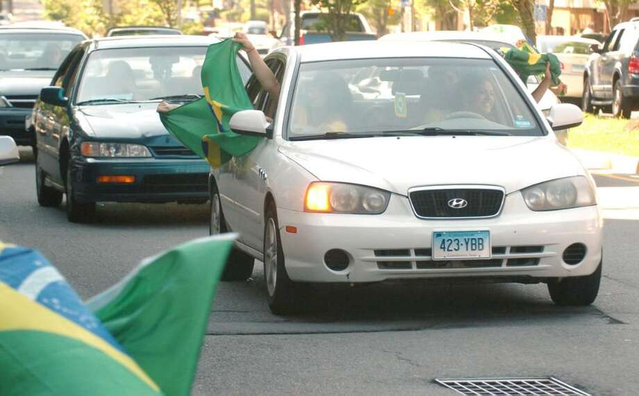 Fans celebrate the World Cup while driving on Main Street in Danbury, June 15, 2010. Photo: Chris Ware / The News-Times
