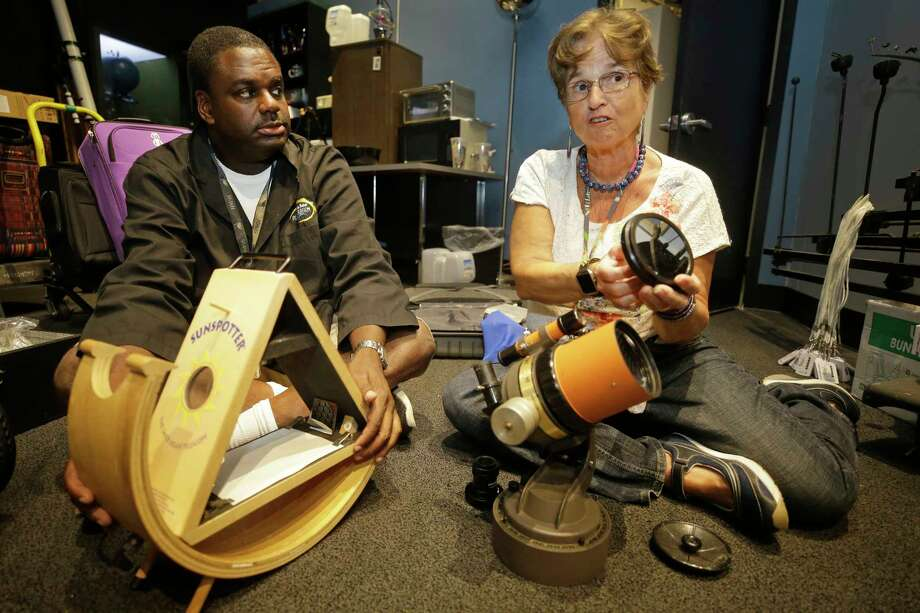 James Wooten, planetarium astronomer, left, and Dr. Carolyn Sumners, vice president of astronomy & physics, talk at Museum of Natural Science, 5555 Hermann Park, about the trip they are leading to Casper Wyoming for the solar eclipse shown Wednesday, Aug. 16, 2017, in Houston. Dr. Carolyn Sumners used the same telescope to view an eclipse in Winnipeg in 1979. Photo: Melissa Phillip, Houston Chronicle / © 2017 Houston Chronicle