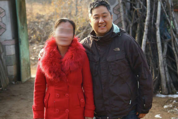 Dan Chung, the author, posted an image of himself standing with a North Korean woman who fled to China in 2001. He obscured her face to shield her identity.