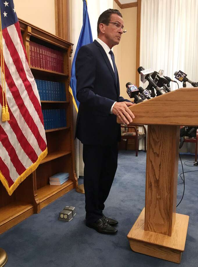 Gov. Dannel P. Malloy stepped up the sense of urgency for a new state budget in a press availability in Hartford on Friday, August 18, 2017. malloy unveiled a plan that would sharply cut state aid to towns and cities and reshuffled school funding if lawmakers cannot agree finally agree on a new budget. Photo: Ken Dixon / Hearst Connecticut Media / Connecticut Post
