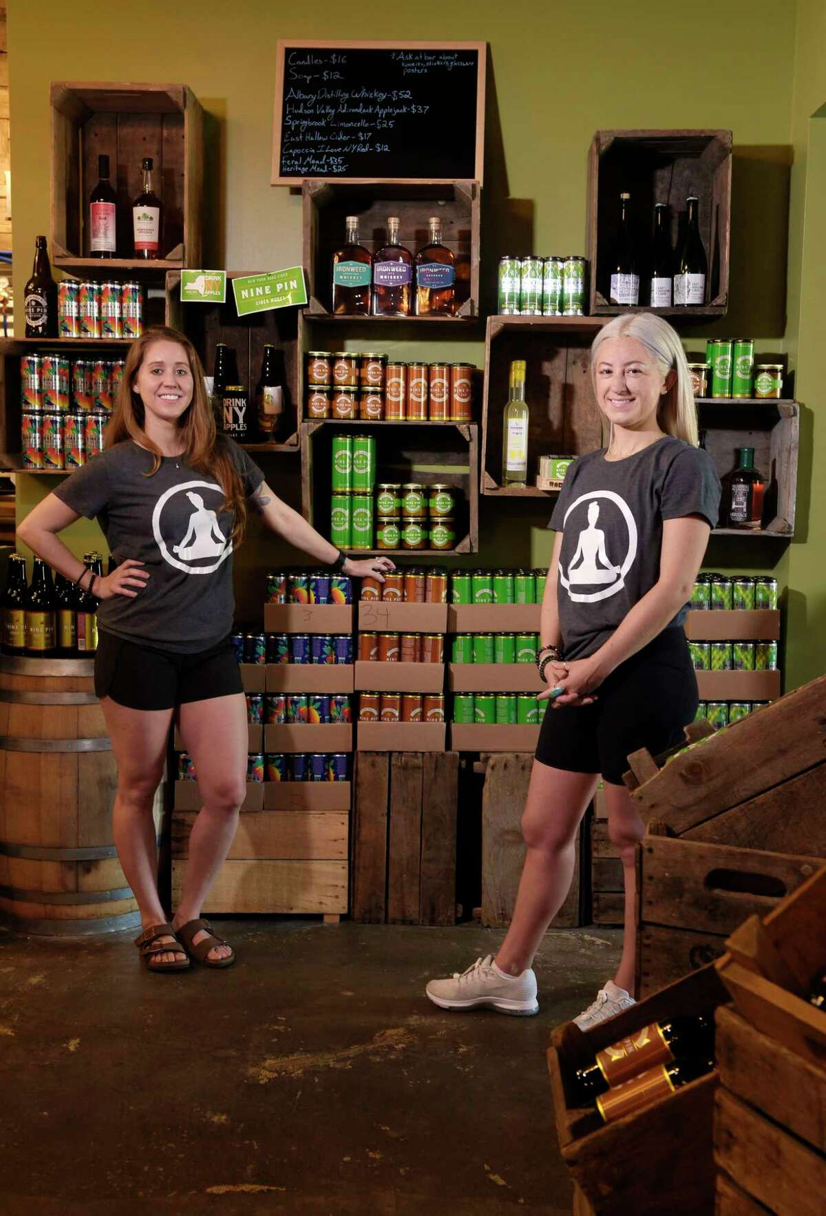 Warehouse Wellness founders, Jenna Rankert, left, and Kristine Williams, pose for a photo inside Nine Pin Cider on Sunday, June 11, 2017, in Albany, N.Y. (Paul Buckowski / Times Union)