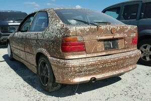 An undated photo shows 1997 BMW 318TI covered in pennies in Houston, Texas. Dallas-based Copart.com listed the vehicle on their website with starting bids as low as $30 as of Aug. 18, 2017.