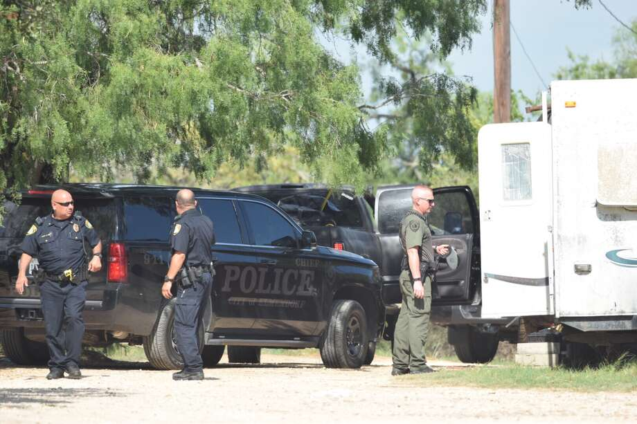 A dog was shot Friday while Elmendorf police and Bexar County deputies issued an arrest warrant. Photo: Caleb Downs / San Antonio Express-News