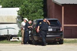 A dog was shot Friday while Elmendorf police and Bexar County deputies issued an arrest warrant.
