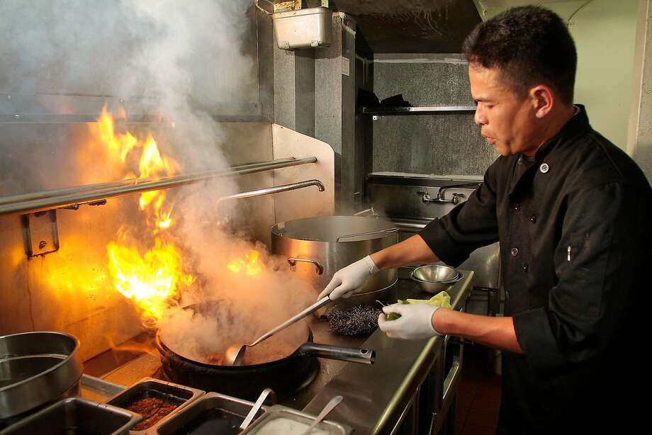 Tom Silargorn makes a sauce at Lers Ros in 2011. Photo: John Storey, Special To The Chronicle