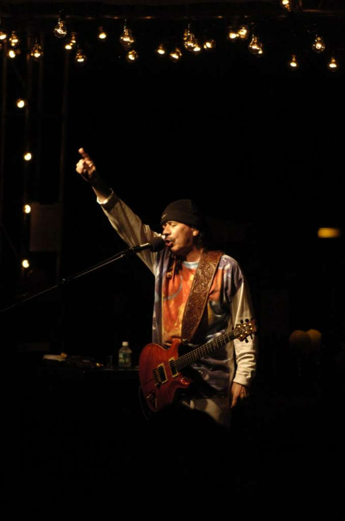 Carlos Santana performs during the annual China Care benefit for Chinese orphans at Belle Haven Club in Greenwich in 2005.