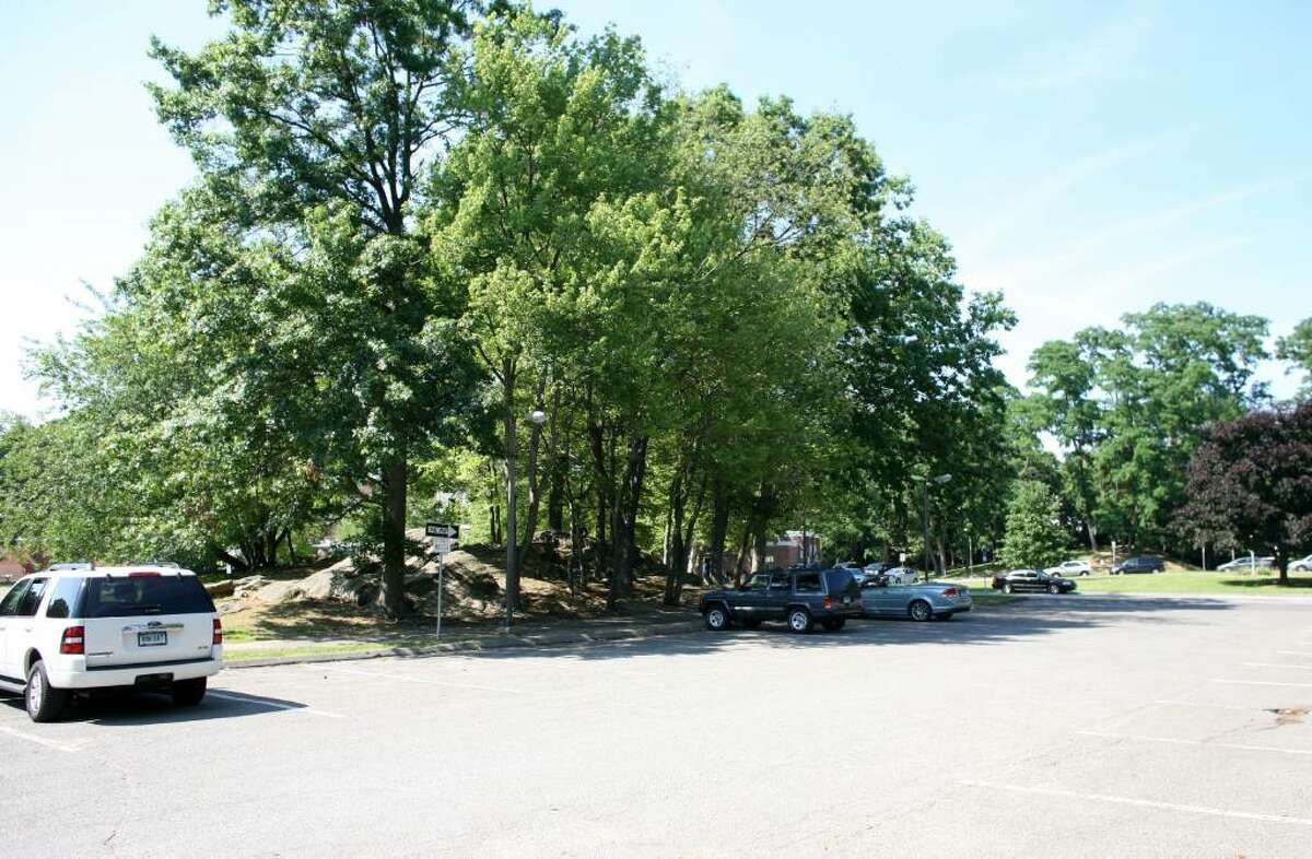 Some North Mianus School parents object to a parking plan that would expand this parking area in front of the school by eliminating the trees, shown Friday afternoon.