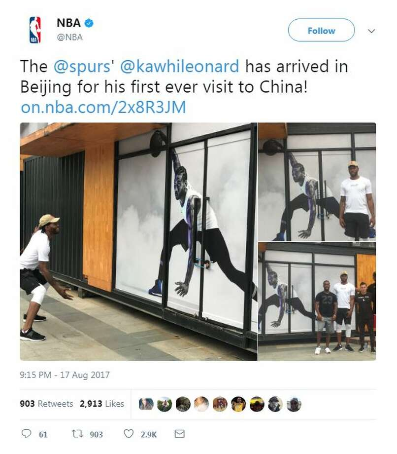 The NBA shared photos of the San Antonio Spurs' Kawhi Leonard visiting a mural of himself during his trip to Beijing. Keep clicking to find out what other Spurs players have been up to during the 2017 summer. Photo: Screengrab/NBA Via Twitter