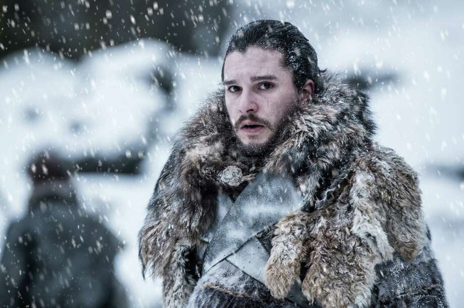 "In this photo provided by HBO, Kit Harington portrays Jon Snow in a scene from the seventh season of HBO's ""Game of Thrones."" Piracy is a long-running and even routine issue for Hollywood, whether it's street vendors hawking bootleg DVDs on street corners or video uploaded to file-sharing sites like Pirate Bay. Now cybercriminals are also putting embarrassing chatter and other company secrets at risk. Separately from HBO's recent run-ins with hackers, upcoming ""Game of Thrones"" episodes have leaked several times, and it is TV's most pirated show. (Helen Sloan/Courtesy of HBO via AP) Photo: Helen Sloan, AP / HBO"