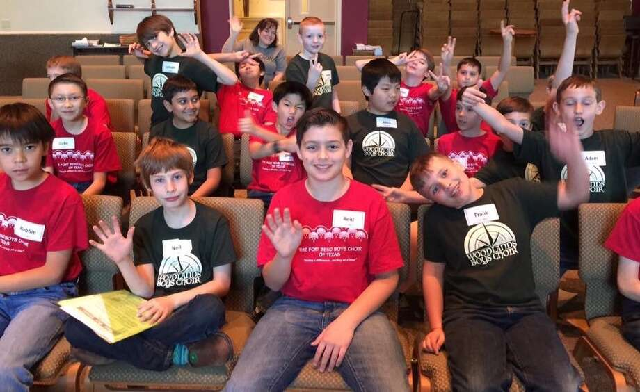 Members of The Woodlands Boys Choir take a break from rehearsal. Founder and director Sherryl Pond, a music minister at Hope Pointe Anglican Church in The Woodlands,  invites boys age 7 to 13 to audition, and attend a one-day mini-retreat Sept. 9. Contact Pond at www.woodlandsboyschoir.org or call (401) 855-3222 for more.