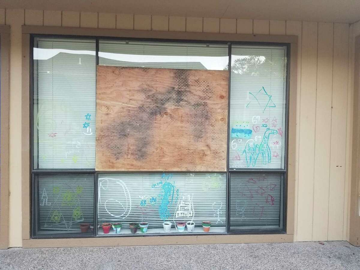 A window of Temple Israel of Alameda was boarded up after a vandal threw rocks at it Wednesday night.