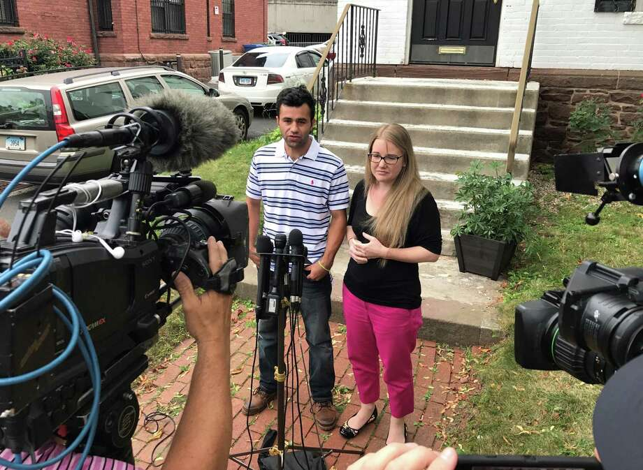 Joel and Samantha Colindres during press conference in front of his attorney's office in Hartford, Conn. Friday, August 18, 2017. Joel Colindres, 33, who came to the U.S. from Guatemala in 2004, had been ordered to leave the country by Aug. 17. Less than an hour before his flight was supposed to leave Thursday afternoon, a federal court issued a temporary stay of his deportation. Photo: H John Voorhees III / Hearst Connecticut Media / The News-Times