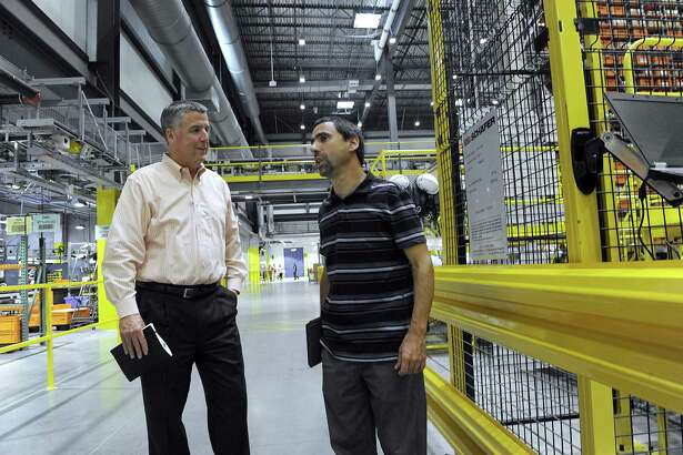 James Furlong, left, president of Belimo Americas and John Forlenzo, a vice president/ customizing and logistics, give a tour of the Danbury facility, Wednesday, August 16, 2017.