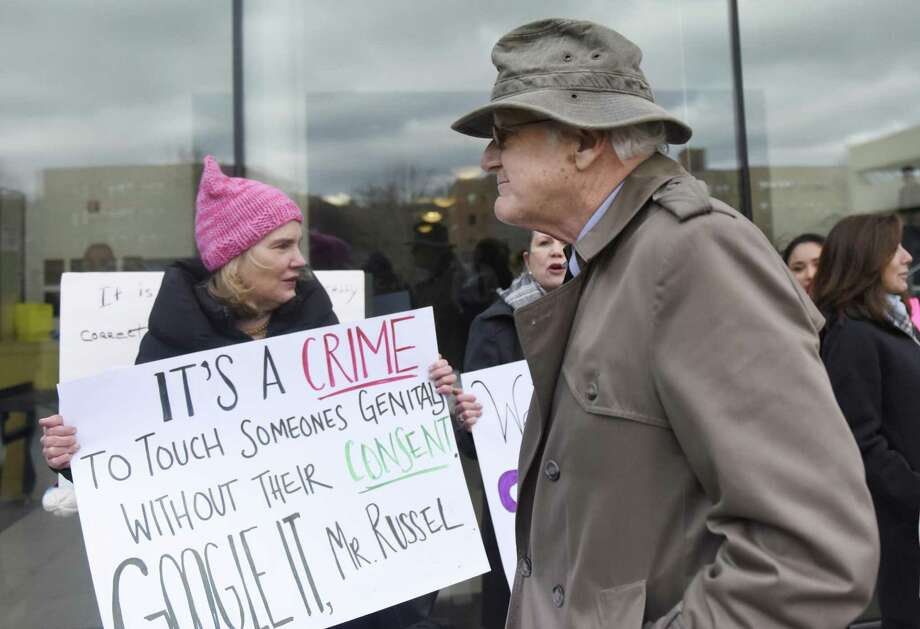 Greenwich Representative Town Meeting member Christopher von Keyserling passes protestors on his way into Connecticut Superior Court in Stamford, Conn. Wednesday, Jan. 25, 2017. Von Keyserling is accused of fourth-degree sexual assault after allegedly groping a woman following an argument between the two in December. The Center for Sexual Assault Crisis Counseling and Education and community activists assembled as von Keyserling entered and exited the courthouse. Photo: Tyler Sizemore / Hearst Connecticut Media / Greenwich Time