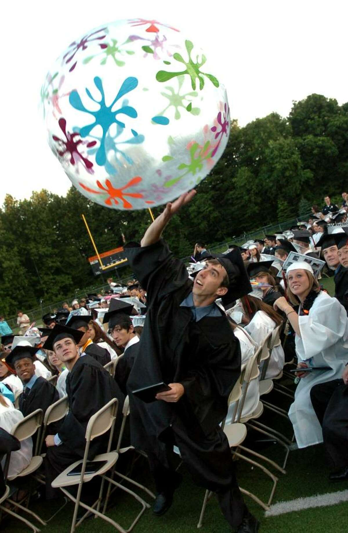 Graduate Nicholas Mavilla swats a big beach ball into the air, during Shelton High School's Graduation Exercises in Shelton, Conn. on Friday June 18, 2010.