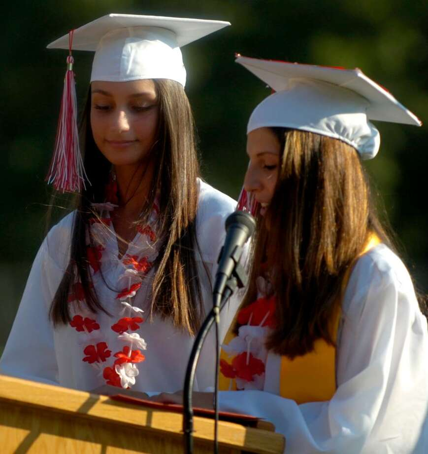 Class Presidents Mary Hyde, left, and Desantilia Gjata, right, speak to seniors during the Derby High School graduation ceremony Friday, June 18, 2010. Photo: Lindsay Niegelberg / Connecticut Post