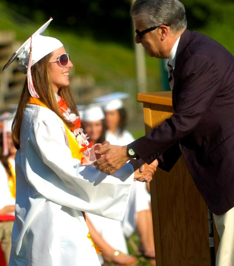 Mary Hyde receives a scholarship presented by Valley Community Foundation President Jamie Cohen during the Derby High School graduation ceremony Friday, June 18, 2010. Photo: Lindsay Niegelberg / Connecticut Post