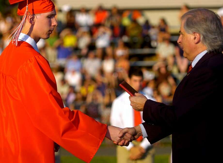 Jason Bukowski receives his diploma during the Derby High School graduation ceremony Friday, June 18, 2010. Photo: Lindsay Niegelberg / Connecticut Post