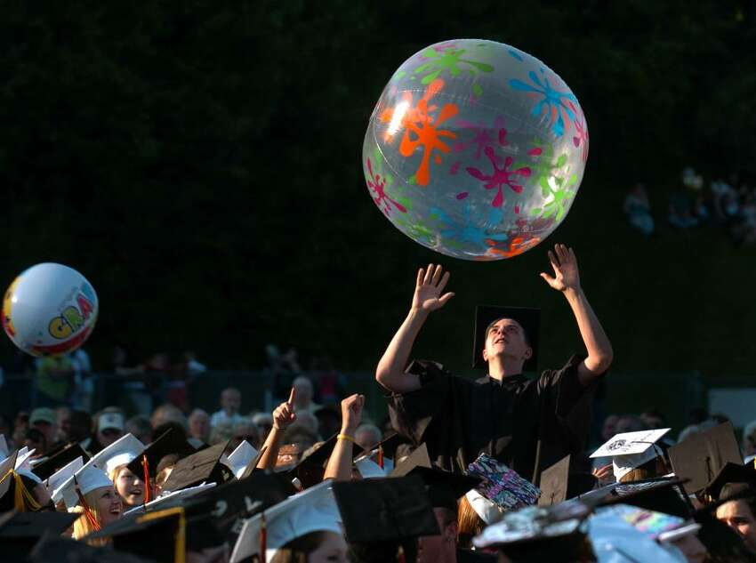 Graduate Alexander Howland gets ready to hit a big beach ball back into the air, during Shelton High School's Graduation Exercises in Shelton, Conn. on Friday June 18, 2010.