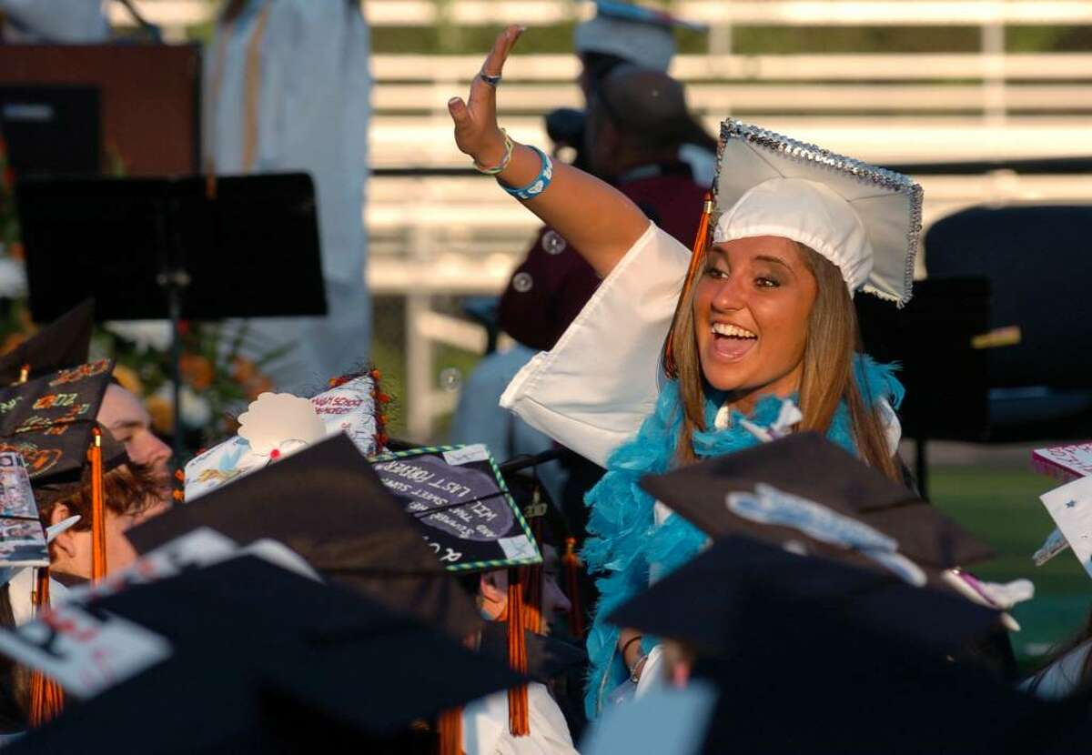 Graduate Kirstin Cunniff waves to her family, during Shelton High School's Graduation Exercises in Shelton, Conn. on Friday June 18, 2010.