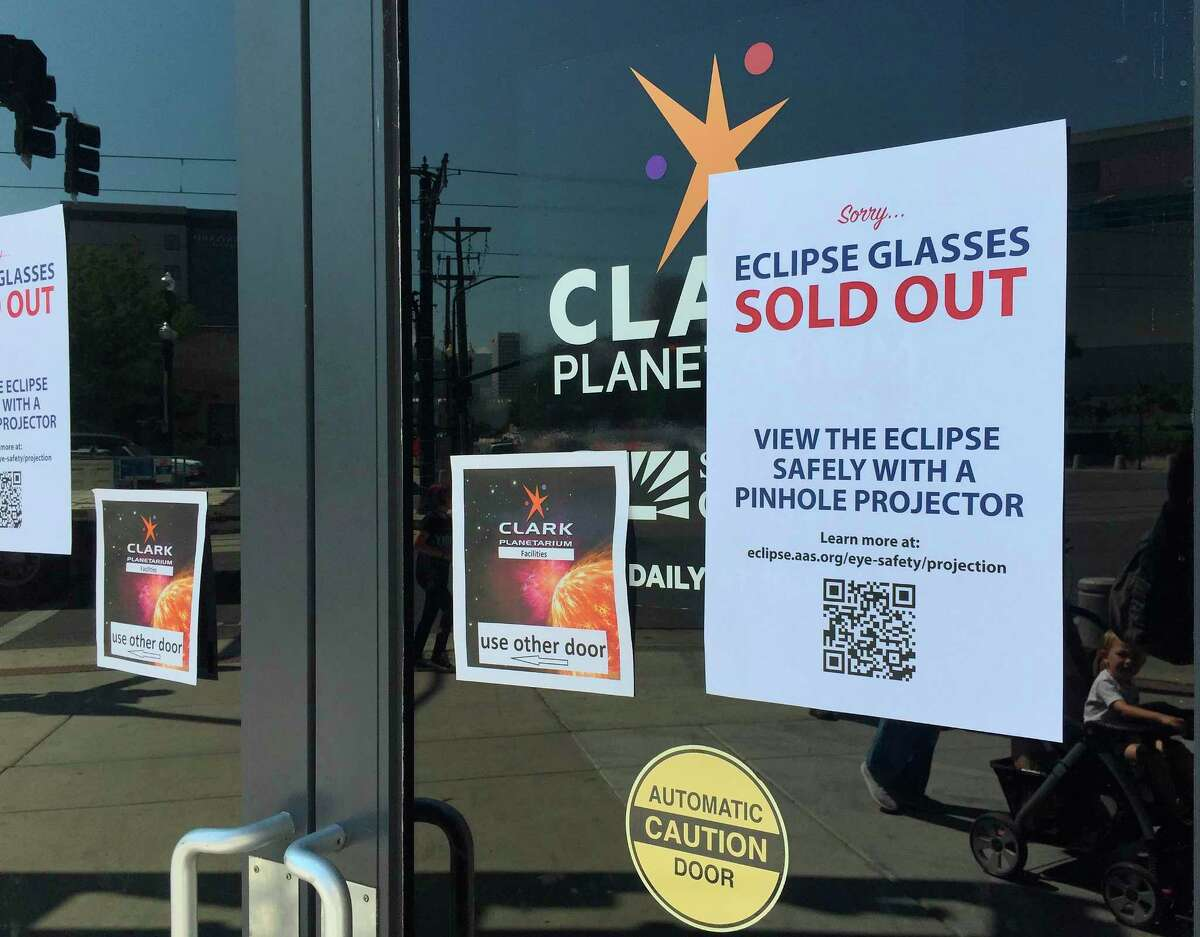 An eclipse glasses sold out sign is posted outside the Clark Planetarium Thursday in Salt Lake City. The glasses were nearly impossible to find by the end of the week.