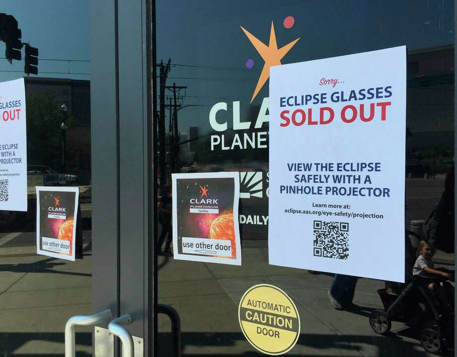 An eclipse glasses sold out sign is posted outside the Clark Planetarium Thursday in Salt Lake City. The glasses were nearly impossible to find by the end of the week. Photo: Brady McCombs, Associated Press / Copyright 2017 The Associated Press. All rights reserved.