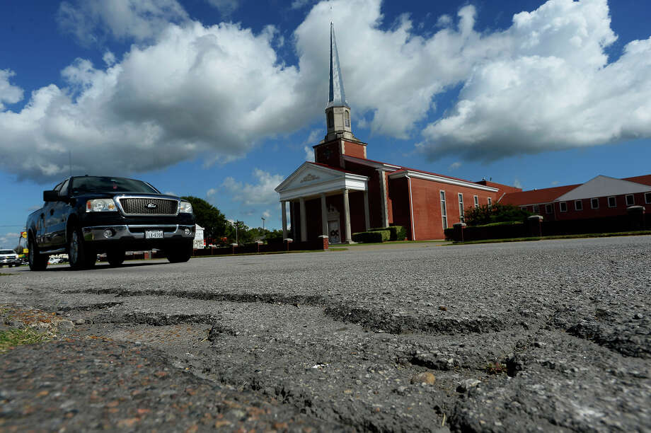 Motorists drive past a section of rough pavement on Nederland Avenue on Monday. The City of Nederland is proposing a complete overhaul of the street between Twin City Highway and U.S. 69.  Photo taken Monday 10/17/16 Ryan Pelham/The Enterprise Photo: Ryan Pelham / ©2016 The Beaumont Enterprise/Ryan Pelham