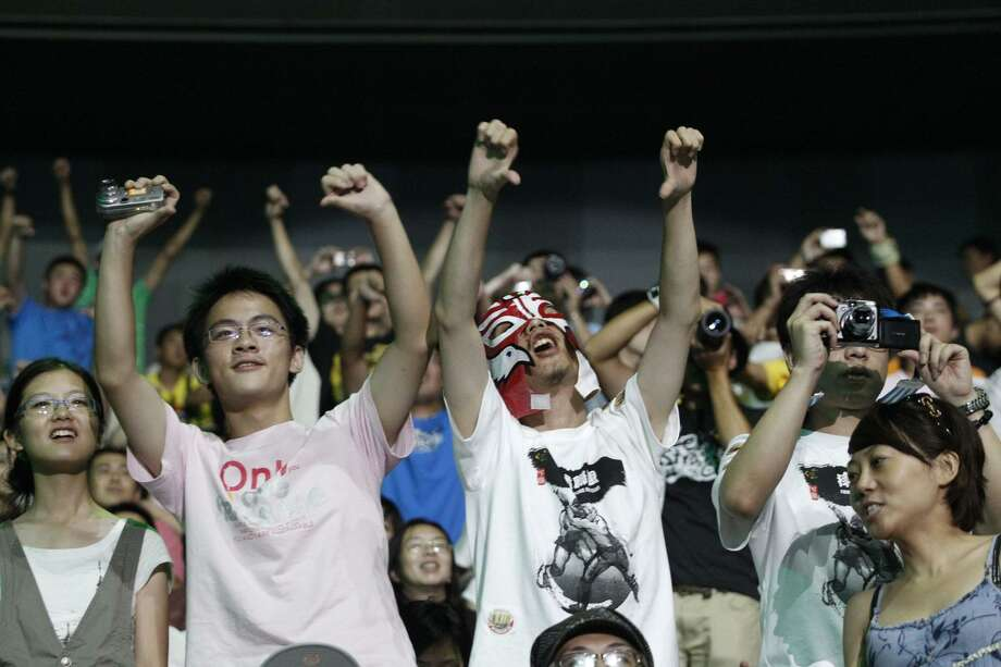 Fans cheer at an arena in Shanghai, China during a WWE show on Sept. 10, 2016. Photo: File Photo / Stamford Advocate Contributed