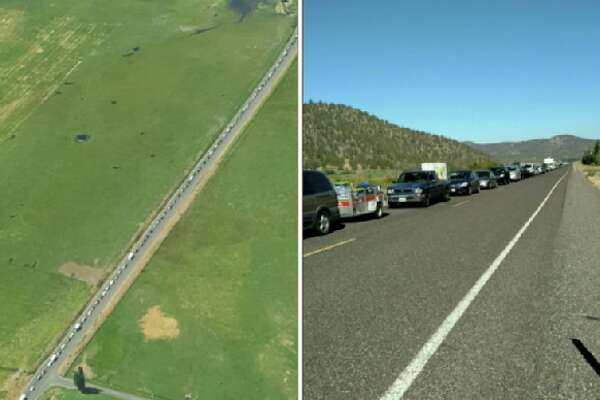 Oregon State Police shares a photo of traffic backed up for 15 miles on Highway 26, all the way to Prineville on Thurs., Aug. 17 at 2 p.m. About 1 million people are expected to visit Oregon — and up to 200,000 to Central Oregon — in the coming days to see the total solar eclipse.