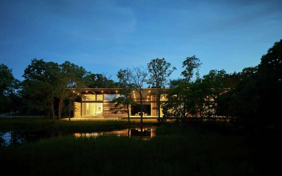 The Ledbetter home of  Brad Nagar and Reid Sutton sits on more than 48 acres on which they've groomed several hiking trails. Photo: Dror Baldinger, Architectural Photography, LLC / © Dror Baldinger, AIA