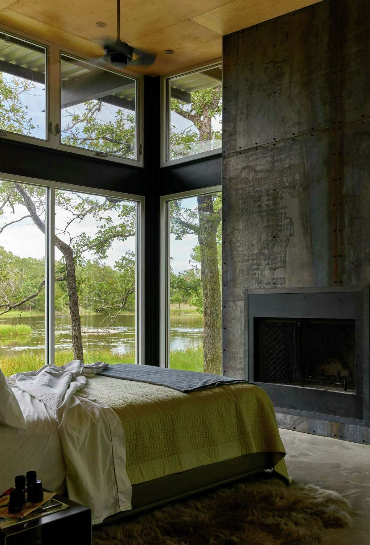 Sheets of Corten steel adorn the fireplaces in the home.