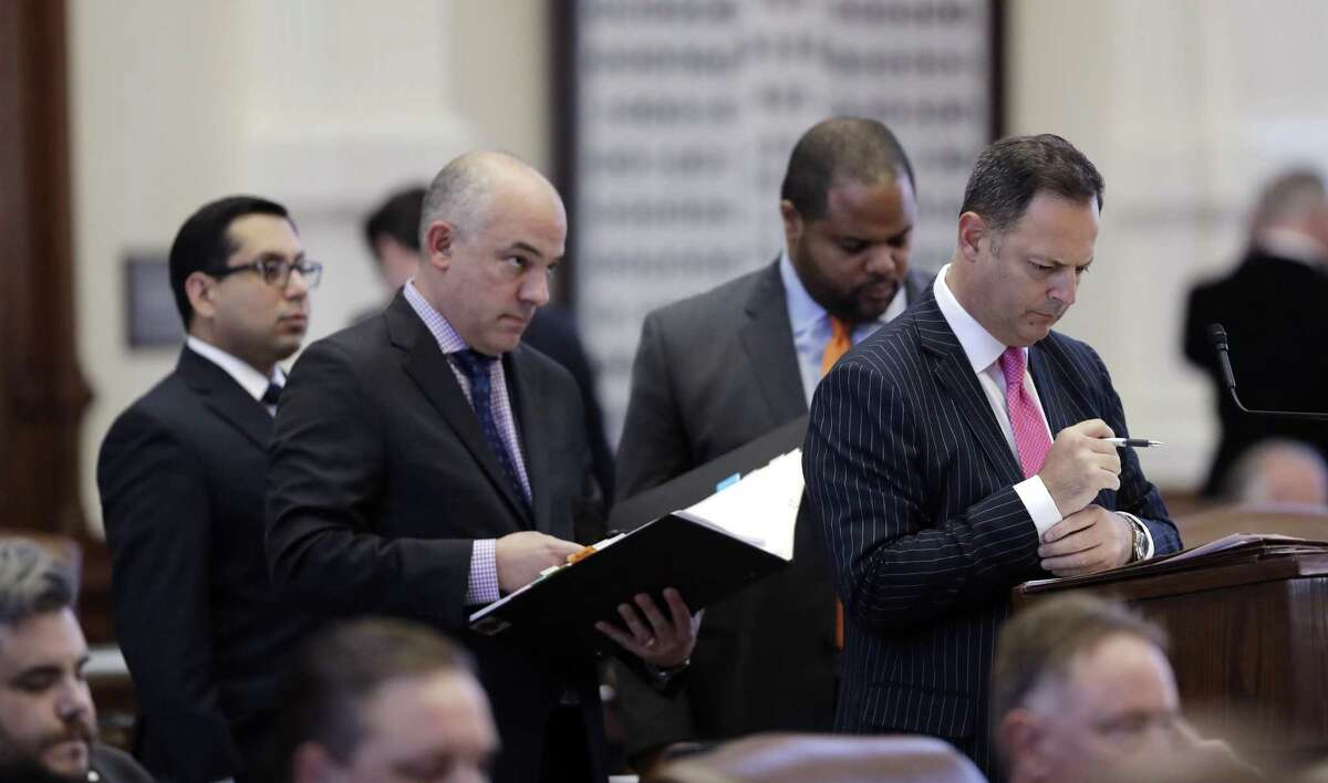 Texas Democratic lawmakers, from left, Rep. Diego Bernal, D-San Antonio, Rep. Chris Turner, D-Arlington, Rep. Eric Johnson, D-Dallas, and Rep. Rafael Anchia, D-Dallas, line up in the House Chamber to ask questions during debate over SB5, a weakened version of the state's voter ID law that a federal judge still called discriminatory.