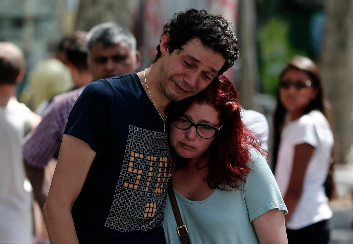 People including relatives of the victims gather and mourn at La Rambla boulevard for the victims those who lost their lives in terror attack killing at least 13 people when a white van plowed into a crowd in central Barcelona, on August 18, 2017, Barcelona, Spain. (Photo by Burak Akbulut/Anadolu Agency/Getty Images)