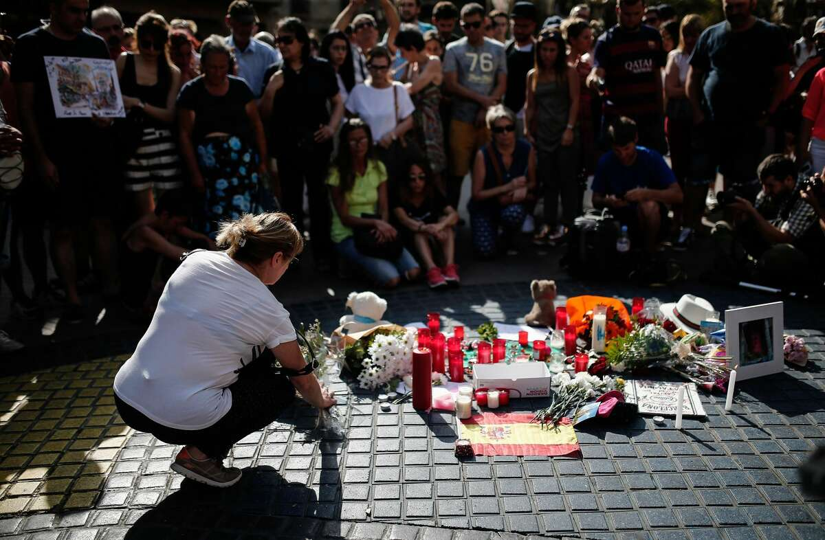 People gather and mourn at La Rambla boulevard for the victims those who lost their lives in terror attack killing at least 13 people when a white van plowedinto a crowd in central Barcelona, on August 18, 2017, Barcelona, Spain. (Photo by Burak Akbulut/Anadolu Agency/Getty Images)